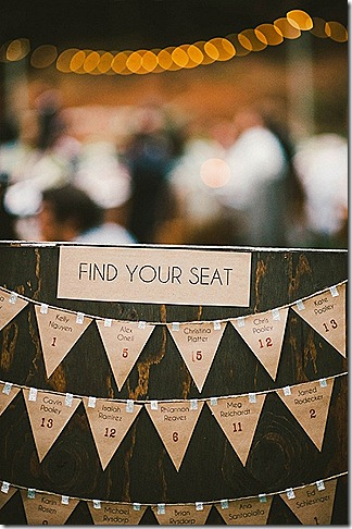 seating chart- rustic wood backdrop